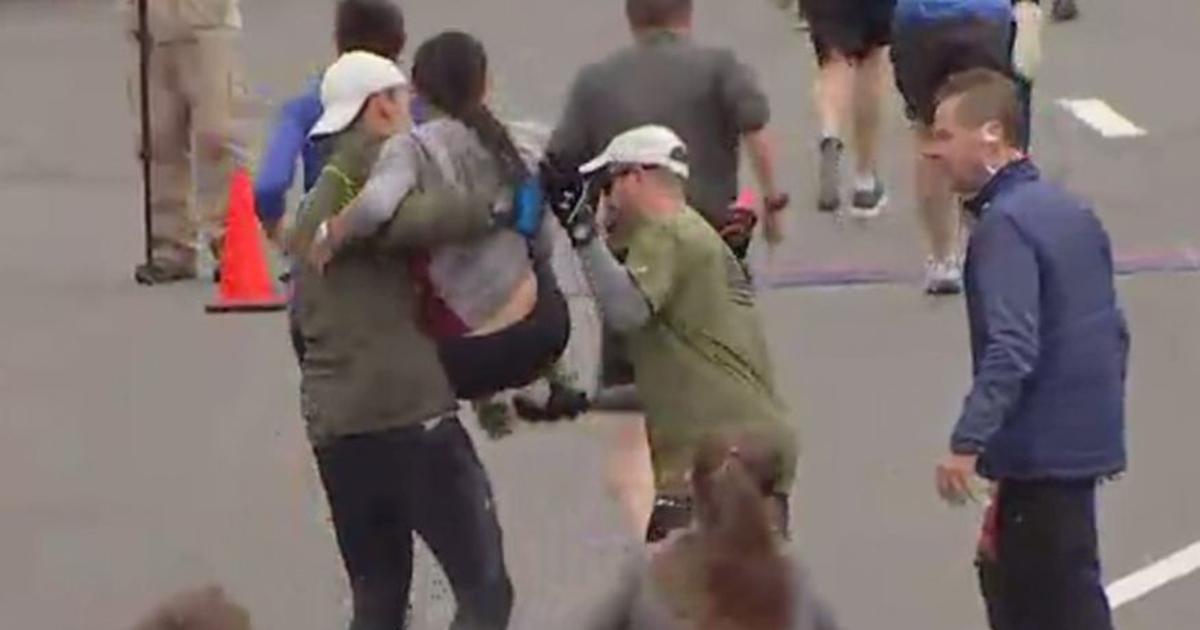 Runners Carry Struggling Woman Over Half-Marathon Finish Line ...