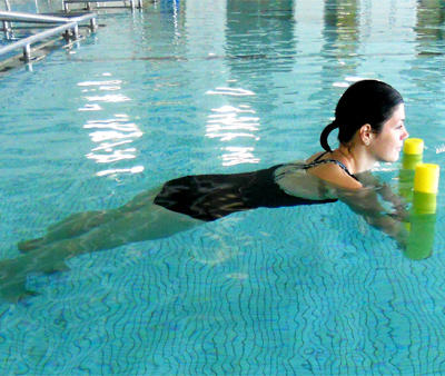 How To Burn Calories In The Pool Without Swimming A Single Lap Shape Magazine
