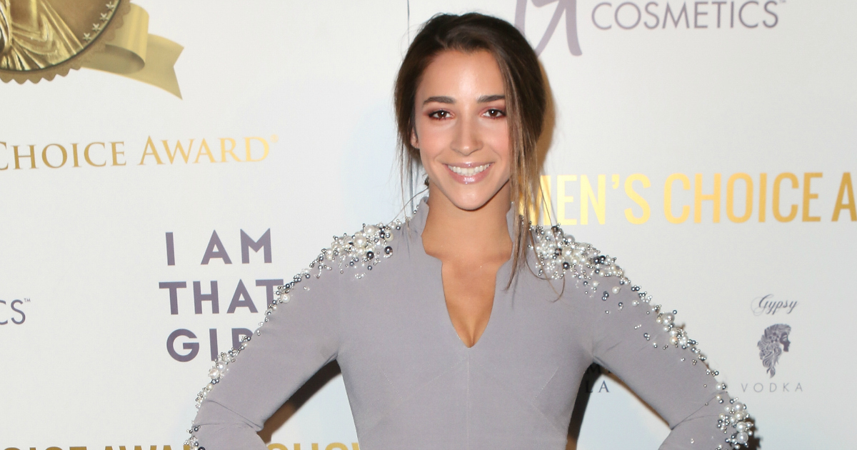 Aly Raisman calls out airport worker for 'muscles' comment