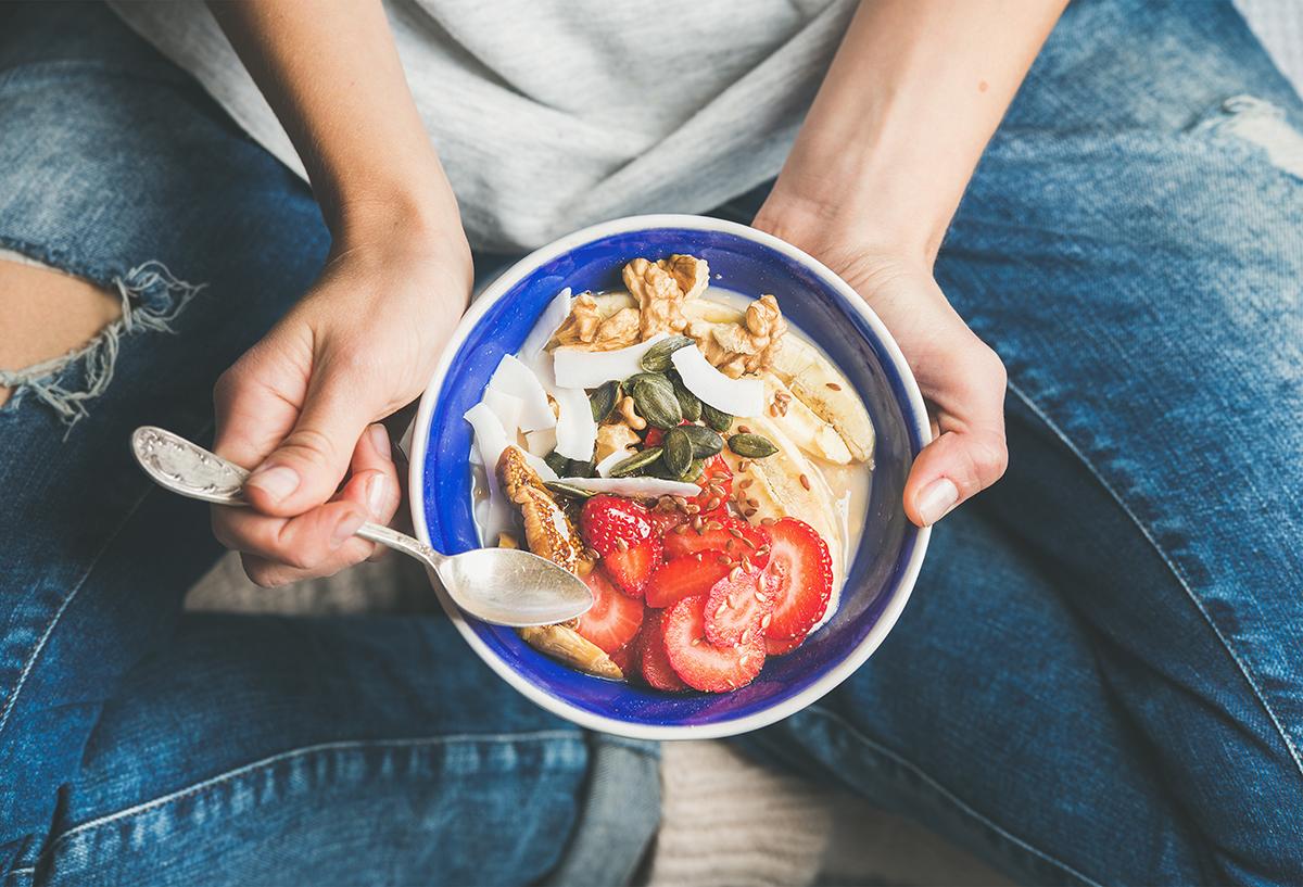 1200-woman-eating-fruit-bowl.jpg