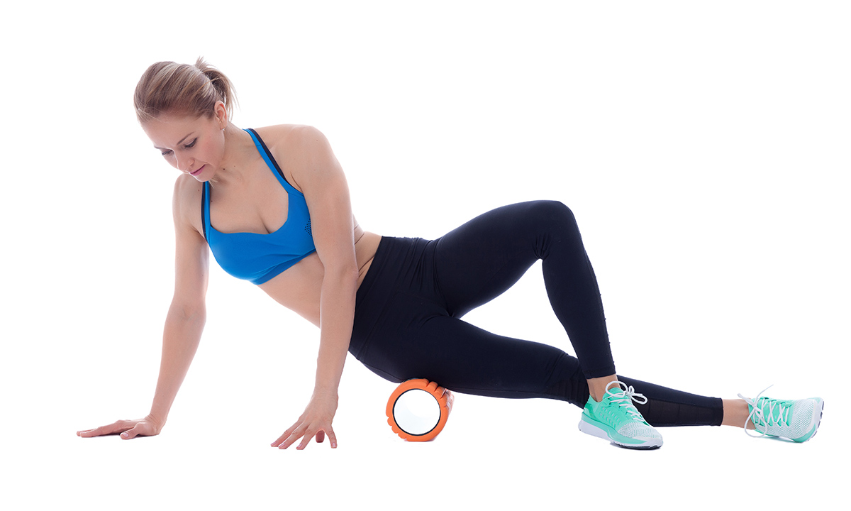 1200-woman-foam-rolling-it-band.jpg