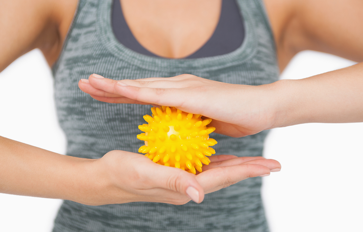 1200-woman-holding-massage-ball.jpg