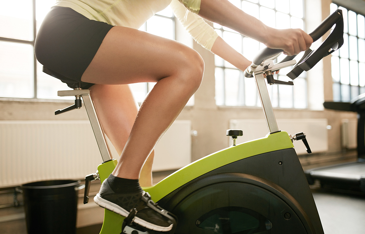1200-woman-indoor-cycling.jpg