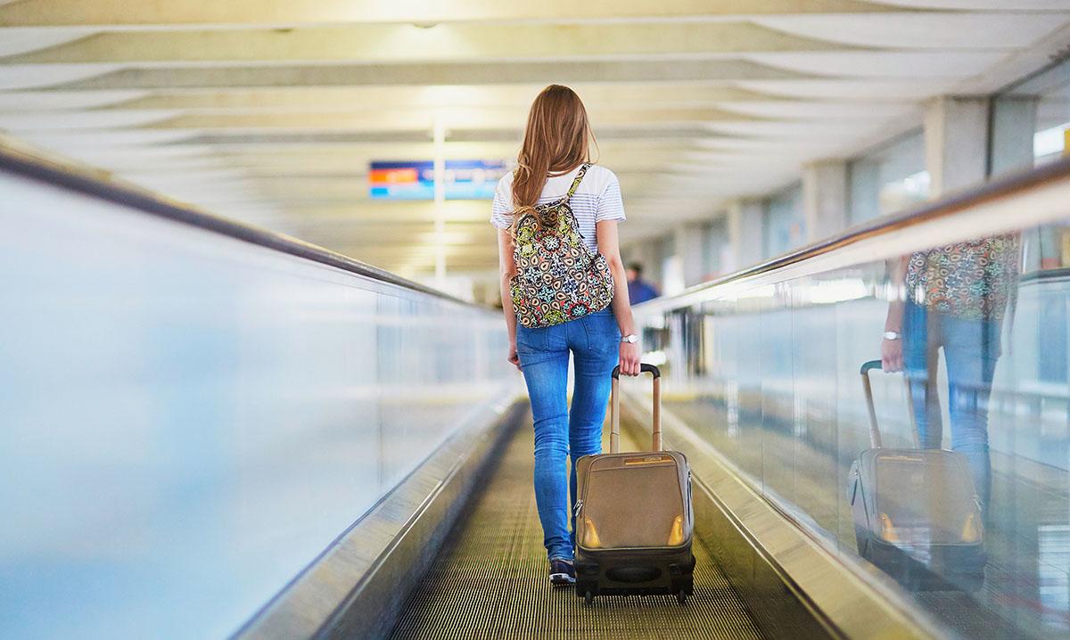 1200-woman-walking-at-airport.jpg