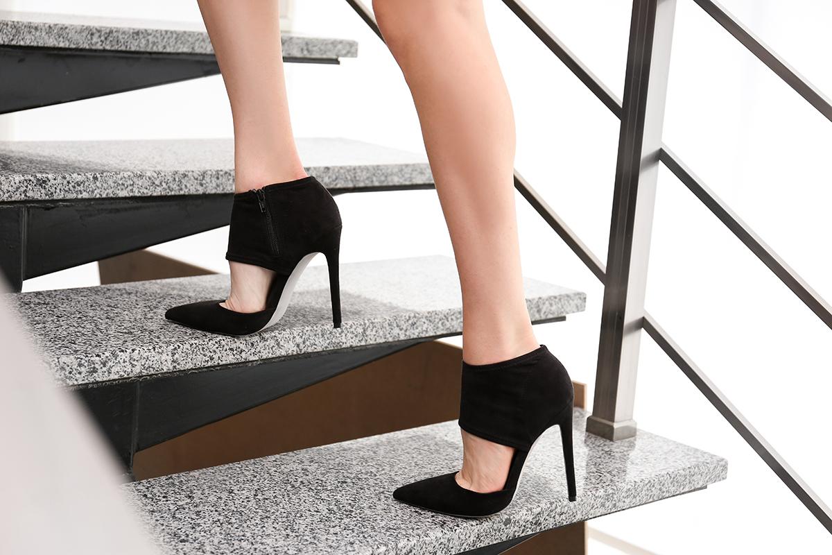 1200-woman-walking-up-stairs.jpg