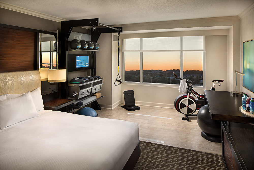 Hilton Debuts Hotel Room That Doubles As A Private Gym