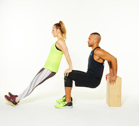 A couple workout doing tripep dips