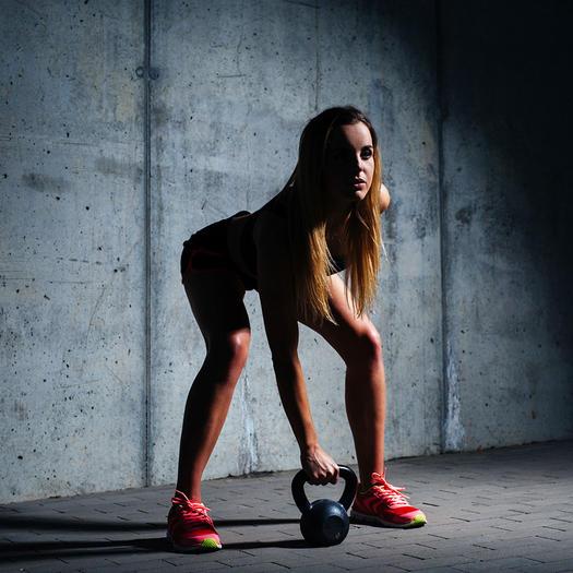 woman doing kettlebell butt exercises