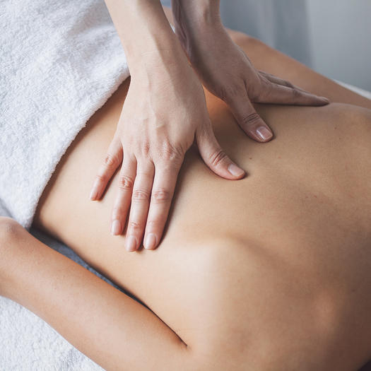 woman getting massage for sore muscle treatment