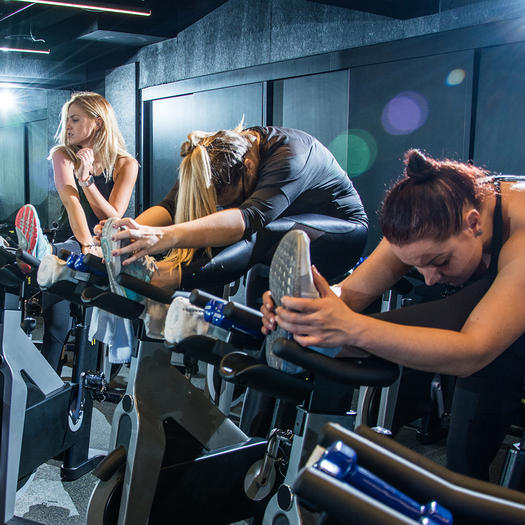 women stretching at the end of spin class