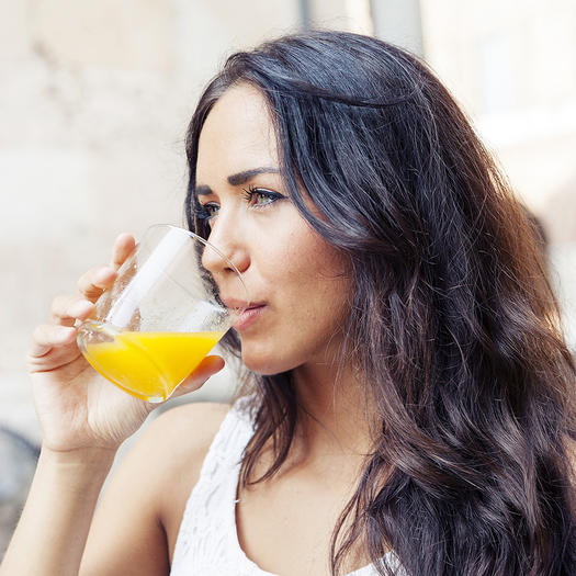woman drinking juice not a healthy drink