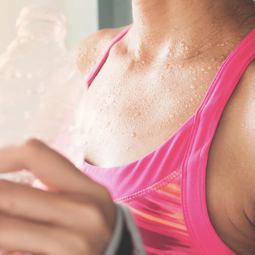 woman sweating workout to increase metabolism