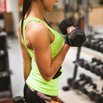 Woman lifting weights for muscle toning
