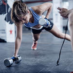 Woman lifting weights for stronger bones
