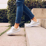 woman-walking-down-stairs-sneakers-jeans