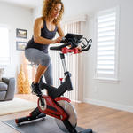 woman checking rpm in spin class