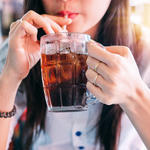 woman drinking soda worst foods to eat