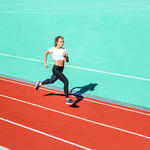 woman running on a track for memory benefits
